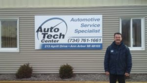 Todd Uguccioni standing in front of Auto Tech Center