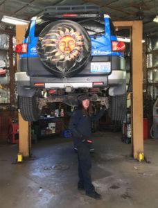 Auto Tech Center mechanic rotating tires