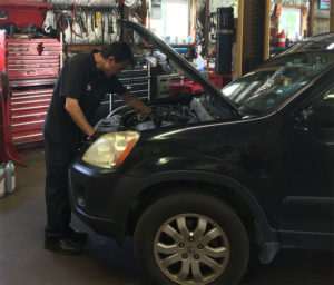 Todd Ugucioni inspecting the check engine light